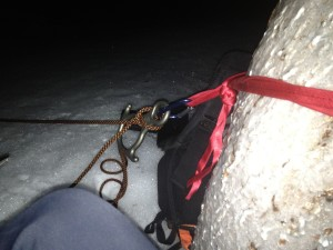 Setting up a belay on an ice encrusted tree